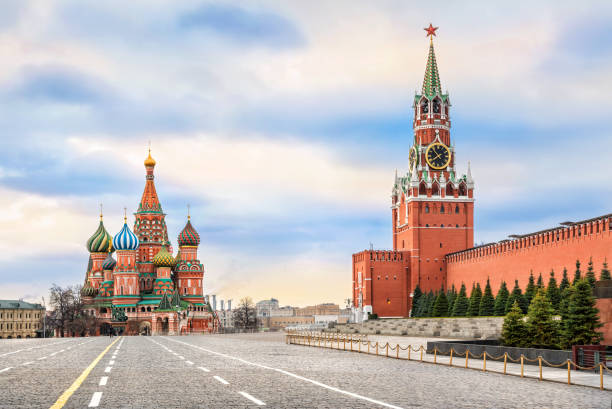 Red Square without the sun Spassky Tower and St. Basil's Cathedral on Red Square in Moscow and the colorful sky without the sun kremlin stock pictures, royalty-free photos & images