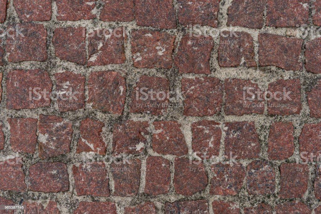 Red squared stones road surface zbiór zdjęć royalty-free