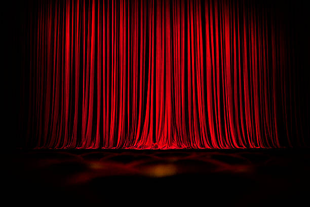 Red Stage Curtains And Empty Seats Stock Photo