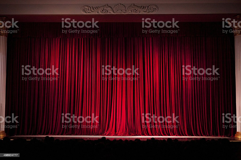 Red Stage Curtains with Audience stock photo