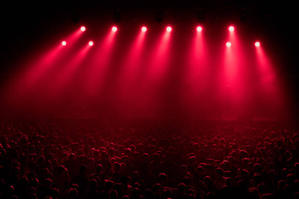 Red stage light with smoke in rock music concert red concert light equipment and crowd of unrecognized people at big music concert in nightclub stage light stock pictures, royalty-free photos & images