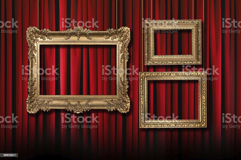 Red Stage Theater Curtains With 3 Hanging Gold Frames royalty-free stock photo