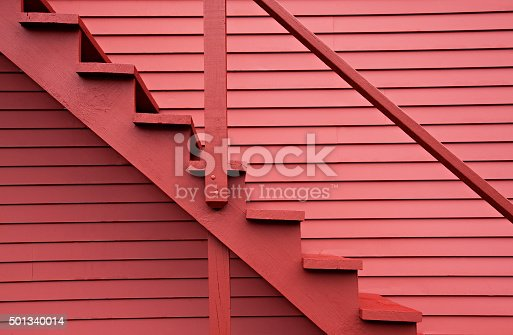 istock Red stairs of the red barn 501340014
