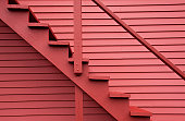 Close up on red stairs of the red building.