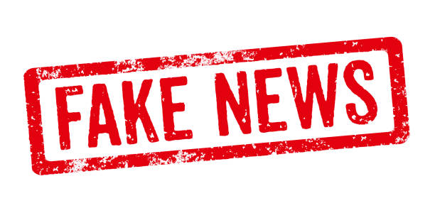 red stamp on a white background - fake news - imitation stock photos and pictures