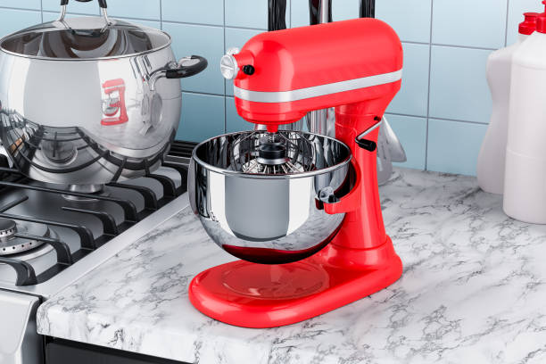 Red stand kitchen mixer on the kitchen table. 3D rendering Red stand kitchen mixer on the kitchen table. 3D rendering electric mixer stock pictures, royalty-free photos & images