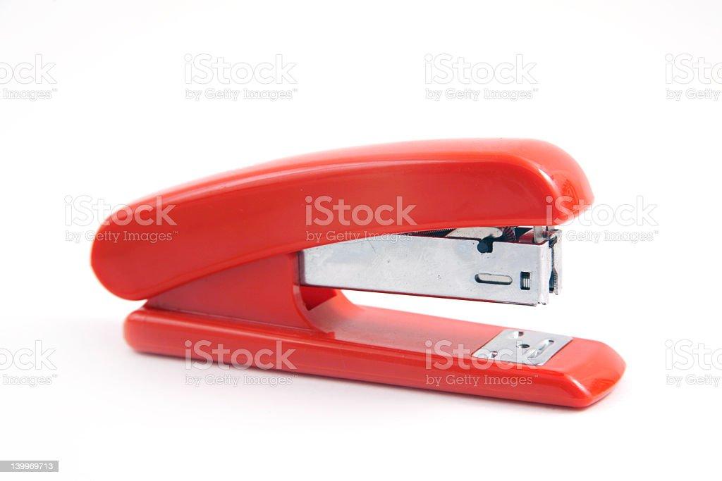 Red stapler on white background stock photo