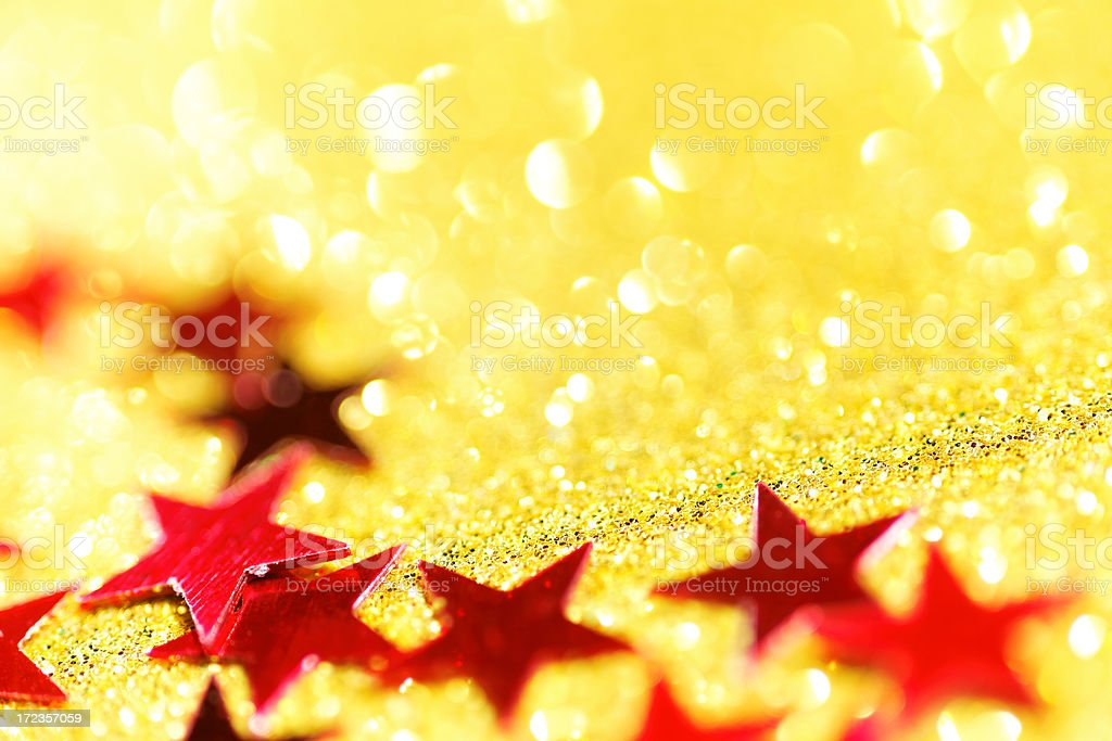 red stars on golden glittering background royalty-free stock photo