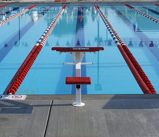 Red starting block in swim lane Swimming lane prepared for competition track starting block stock pictures, royalty-free photos & images