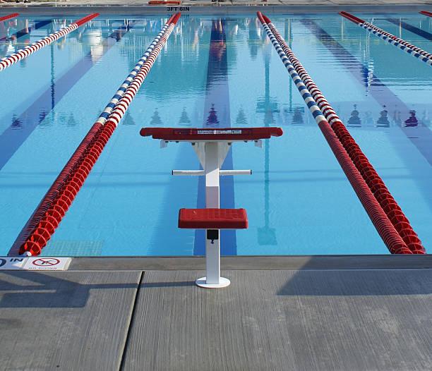 red starting block in swim lane stock photo - Olympic Swimming Starting Blocks