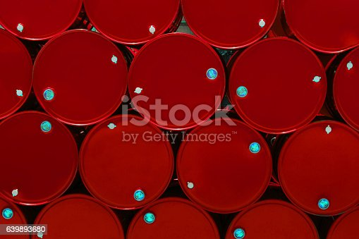 istock red steel chemical tanks or oil tanks stacked in row. 639893680
