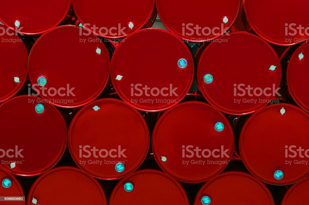 red steel chemical tanks or oil tanks stacked in row. stock photo