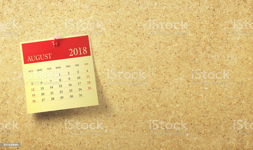 Red Sticky Note Calendar with Push Pin on Cork board : August 2018 stock photo