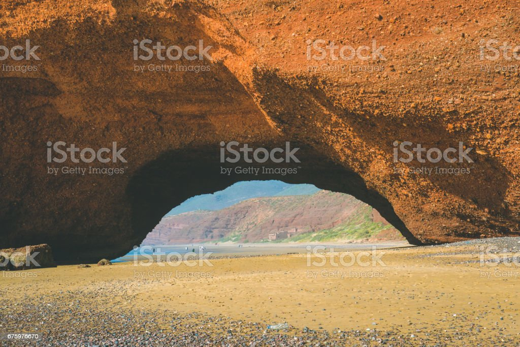 Red Stone Arches, Camel's Foot, in Legzira on the Shores of the Adriatic Ocean, Sidi Ifni, Morocco, Africa stock photo