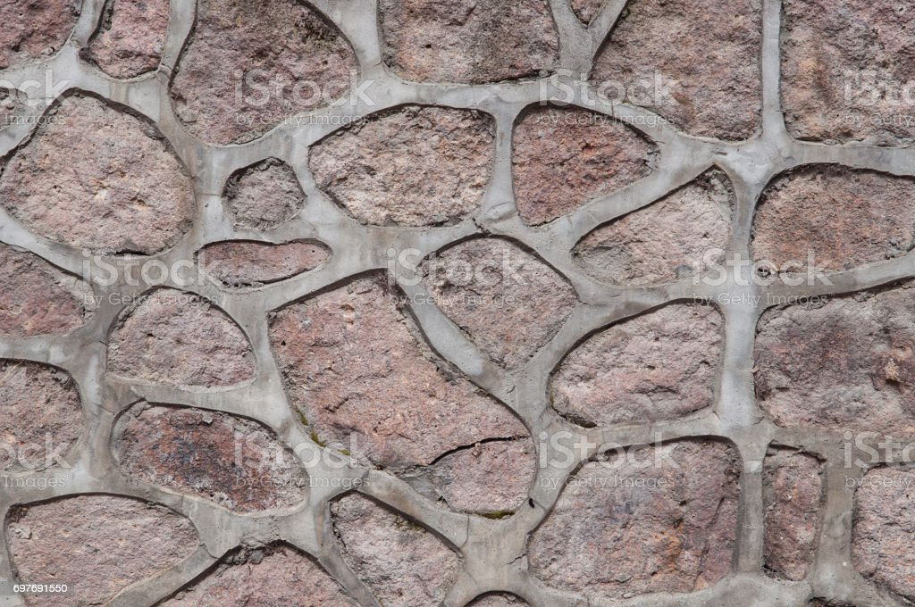 red stone wall texture stock photo