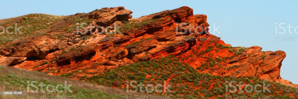 Red stones at tectonic fault stock photo