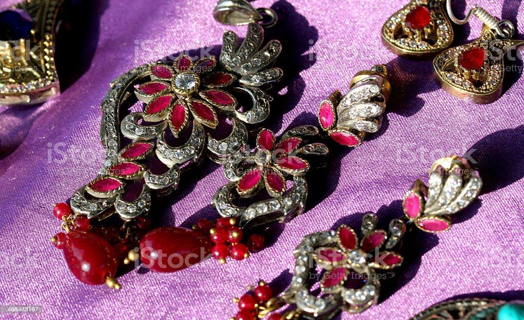 red stones earrings for sale flea market finds stock photo