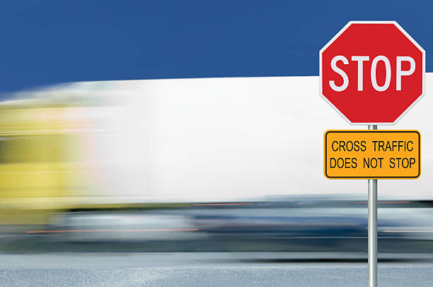 red stop road sign, motion blurred truck vehicle traffic background - stop motion stock photos and pictures