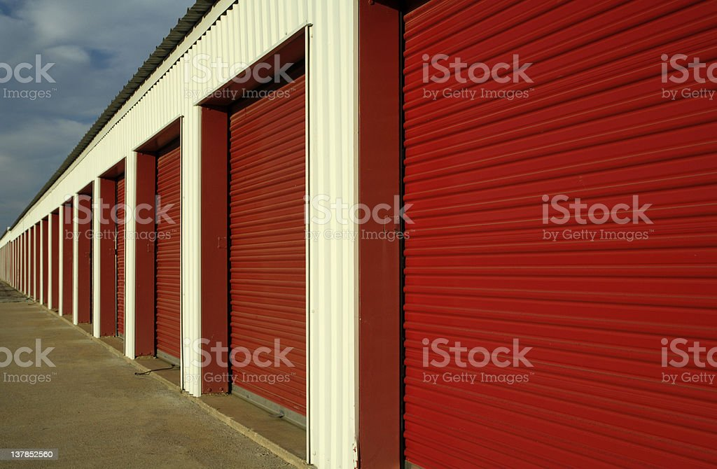Red storage doors in a straight line  stock photo