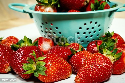 istock red strawberries in colander on a white wooden table 960710550