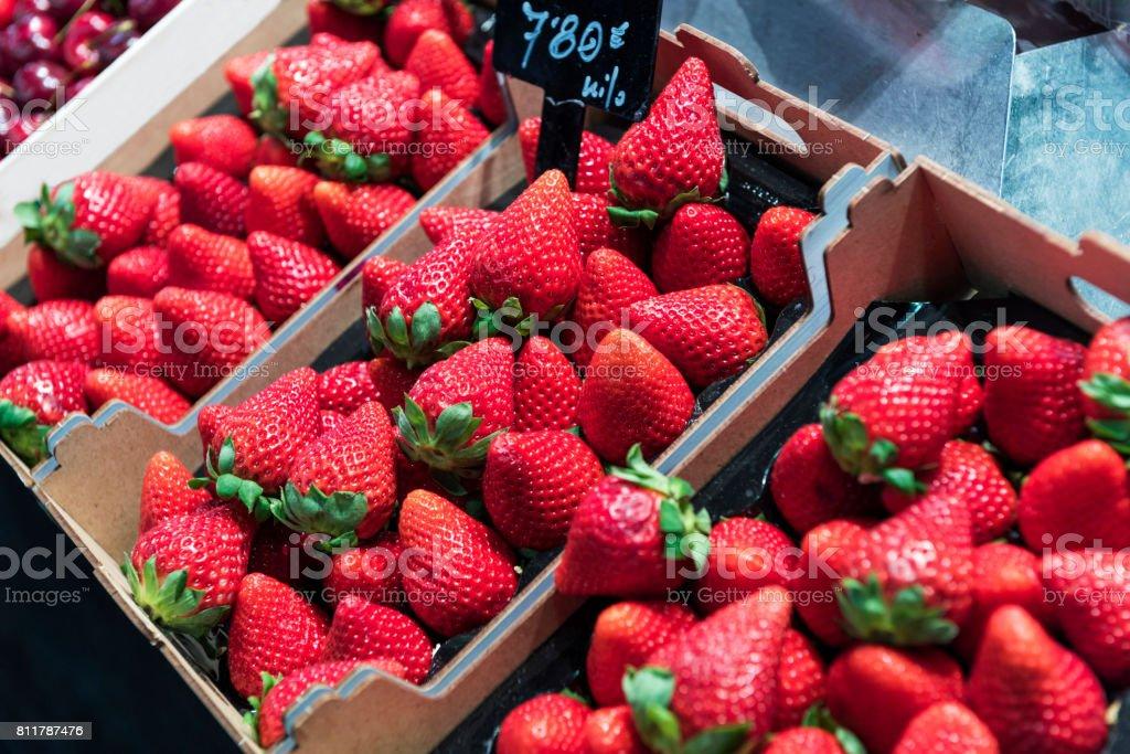 Red Strawberries in La Boqueria Food Market, Barcelona stock photo