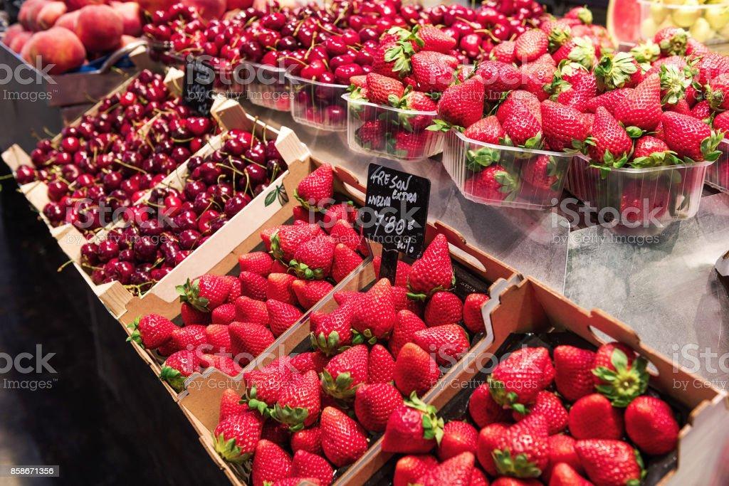 Red Strawberries with cherry in La Boqueria Food Market, Barcelona stock photo