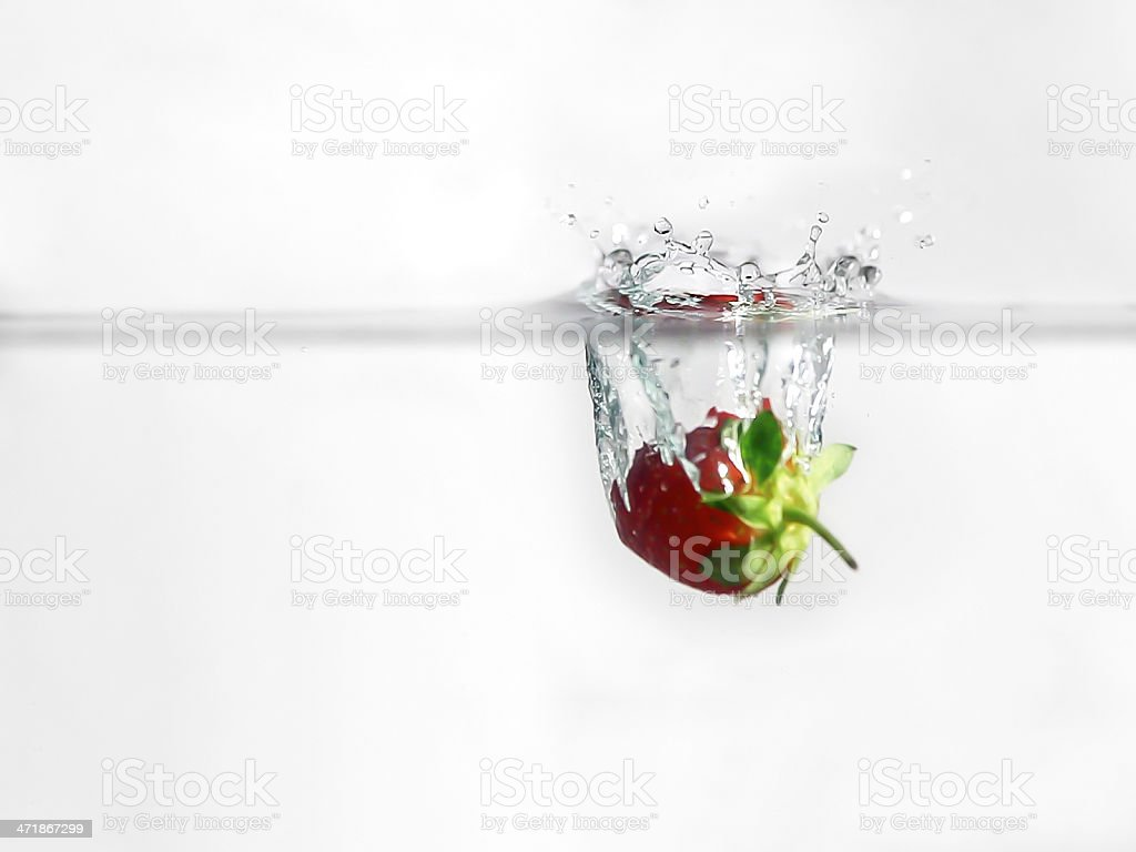 Red Strawberry Splash and White Background stock photo
