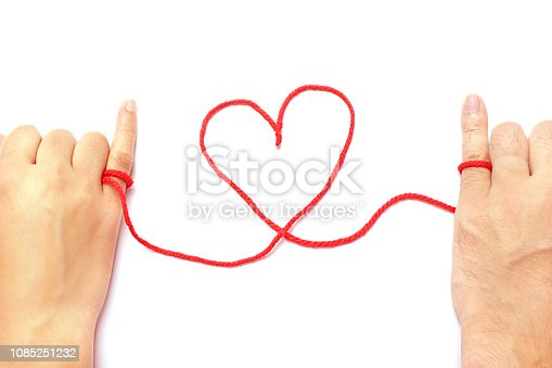istock Red string of fate 1085251232