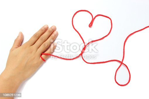 istock Red string of fate 1085251236