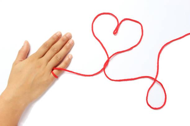 運命の赤い糸 - ロマンス ストックフォトと画像