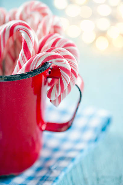 Red striped candy canes in a mug stock photo