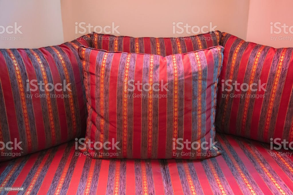 Red Striped Pillows On Sofa Stock Photo & More Pictures of 2018 - iStock