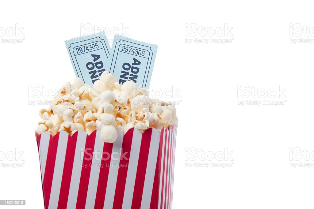 Red Striped Popcorn Bag And Movie Ticket On White Background royalty-free stock photo