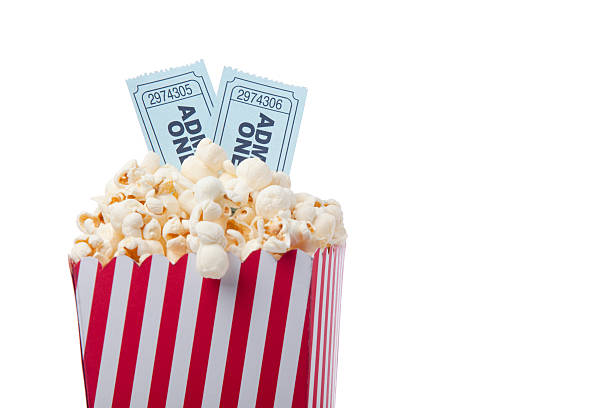 Red Striped Popcorn Bag And Movie Ticket On White Background stock photo