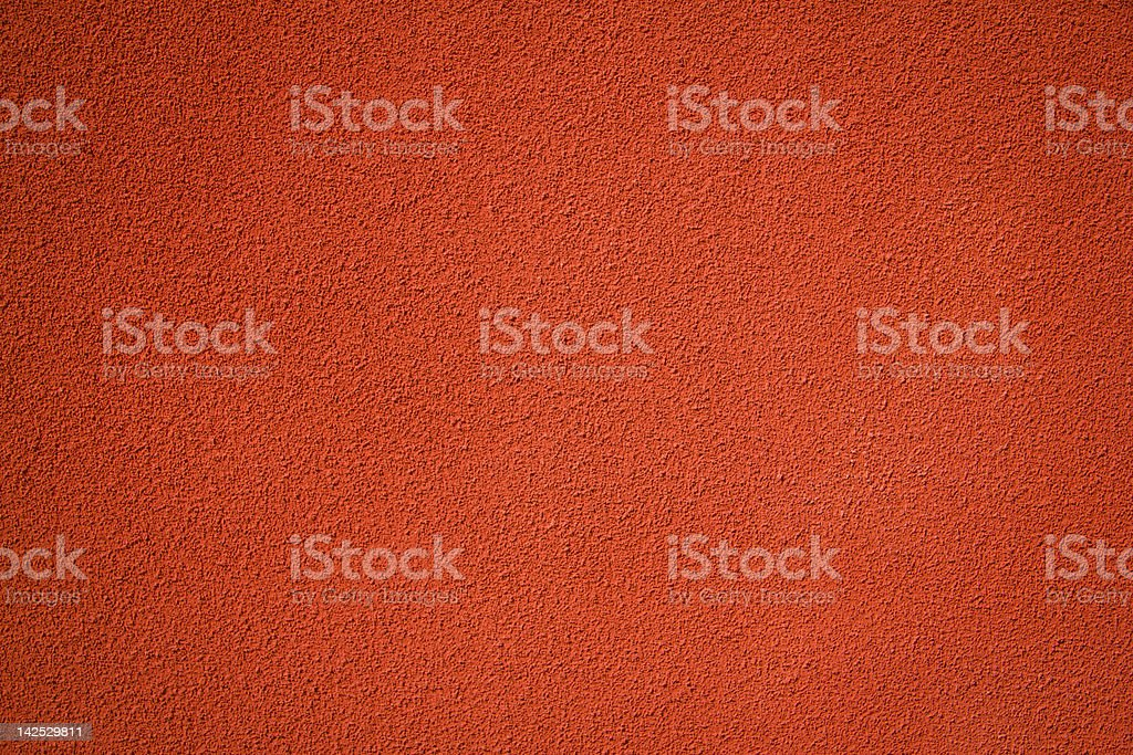 red stucco textured wall background royalty-free stock photo