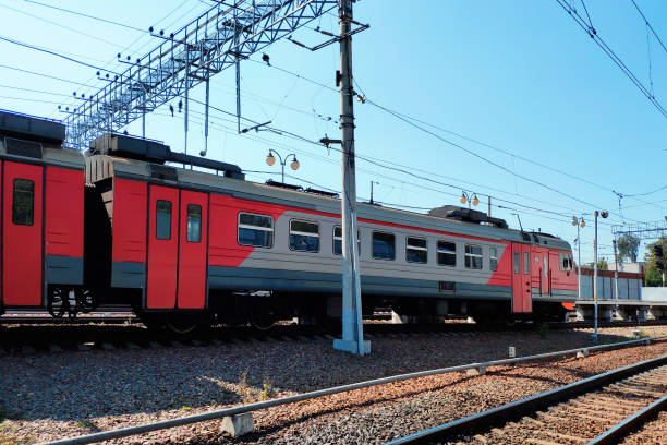 Red suburban train on the station close up. Railway platform with train. Red suburban train on the station close up. Railway platform with train. electric train stock pictures, royalty-free photos & images