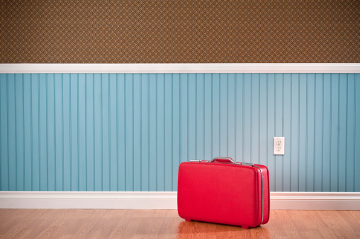 Red Suitcase In Empty Room