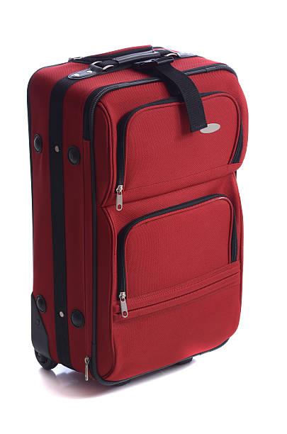 rote koffer - trolley kaufen stock-fotos und bilder