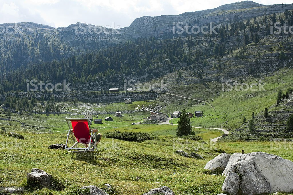 Red sun lounger and mountains royalty-free stock photo