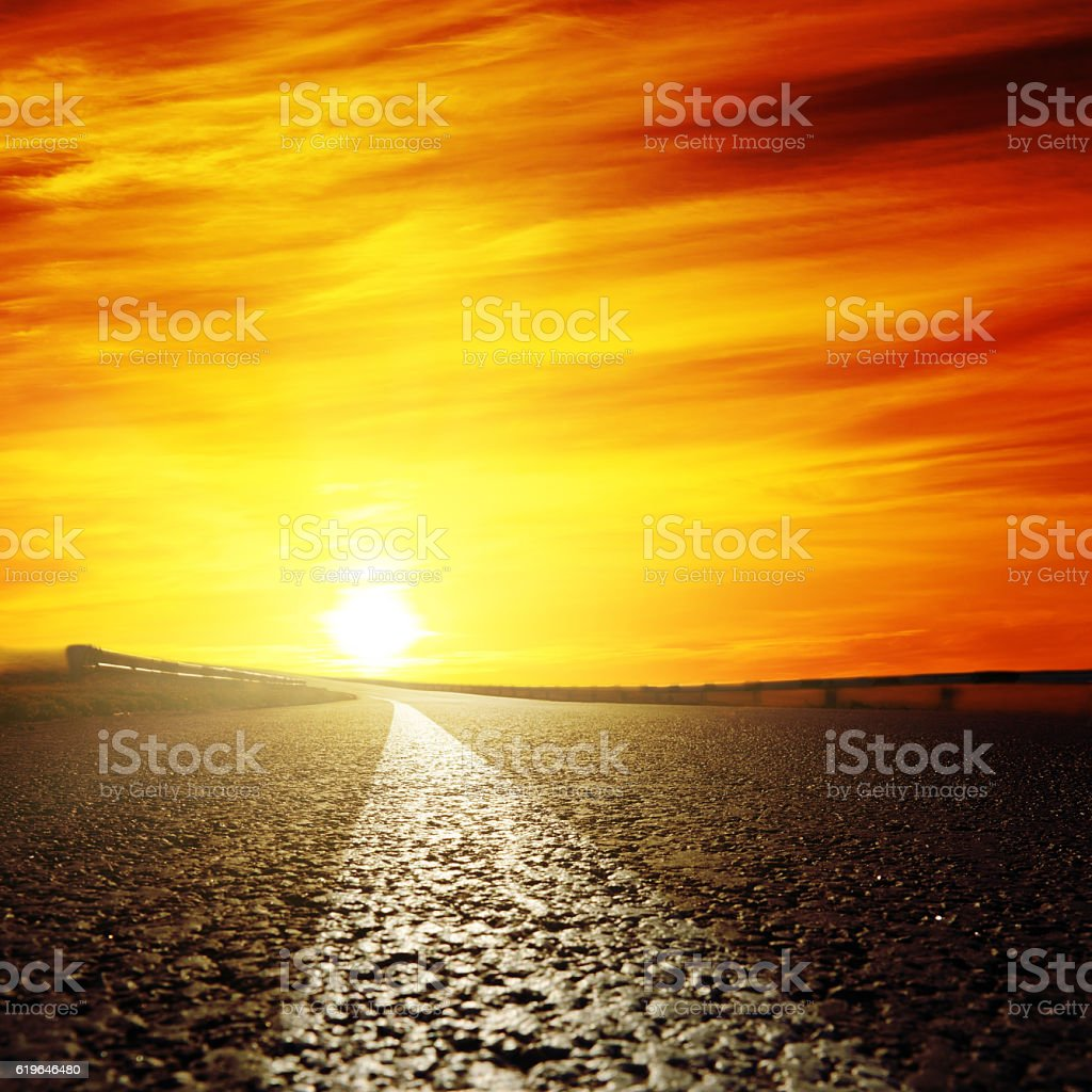 red sunset and asphalt road closeup stock photo