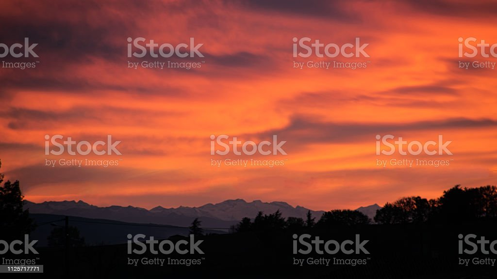 Red sunset and Pyrenees mountains stock photo