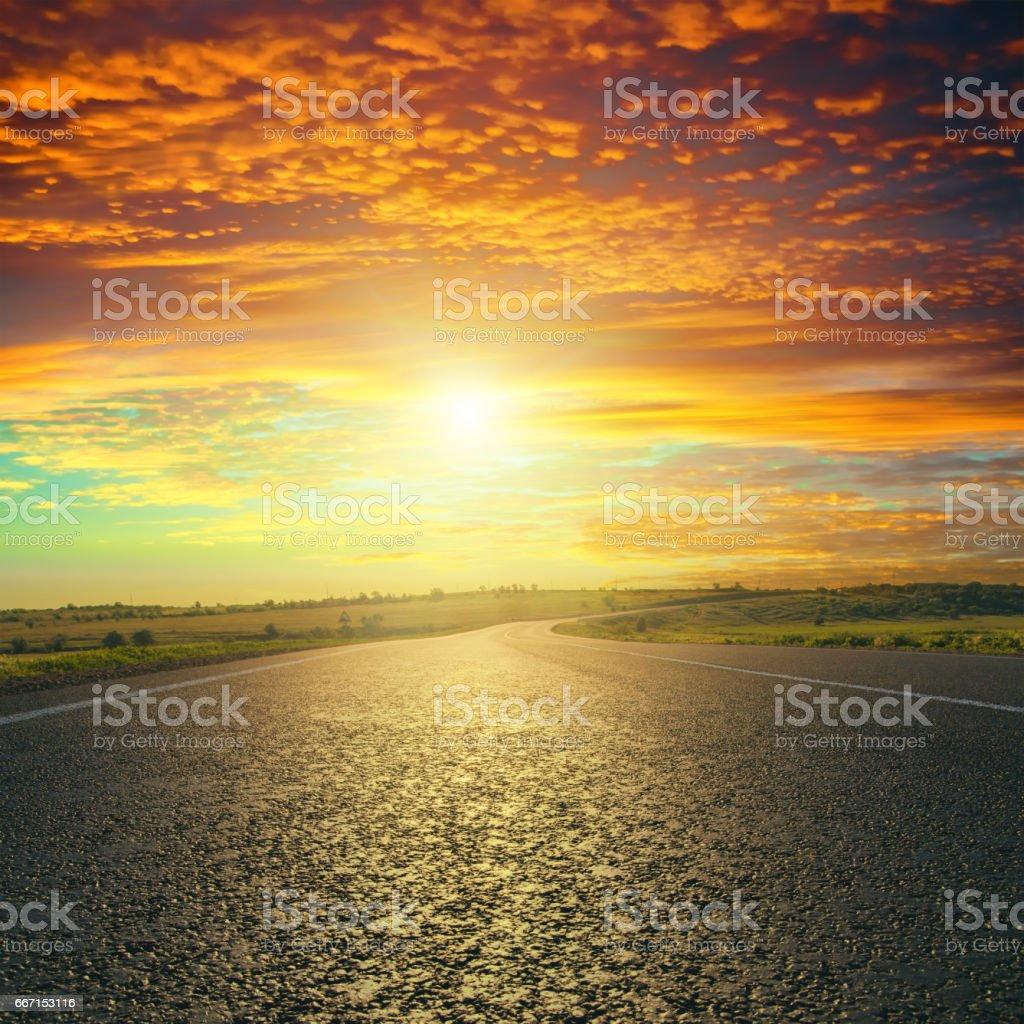 red sunset over asphalt road stock photo