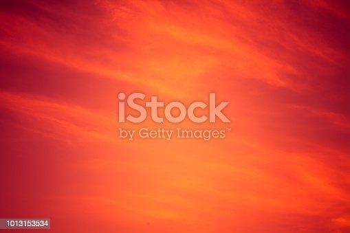 1013154212istockphoto Red sunset sky background. 1013153534