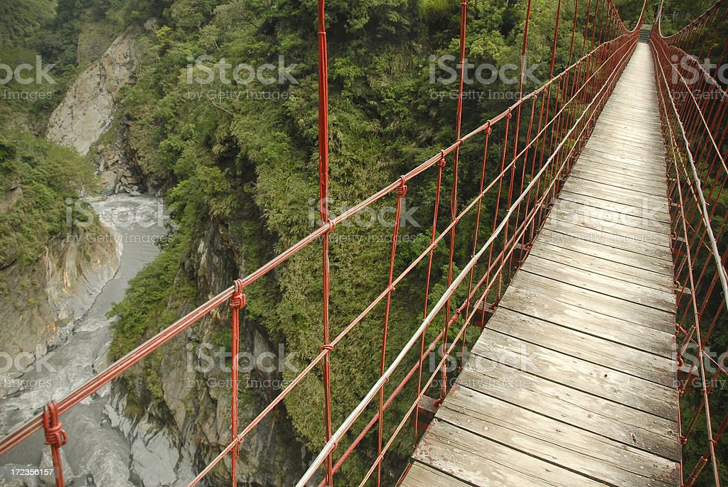 Red Suspension Bridge and River royalty-free stock photo