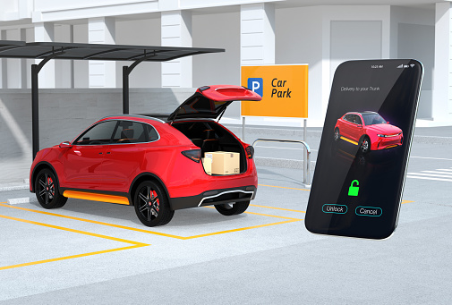 613881746 istock photo Red SUV in parking lot with opened trunk, cardboard boxes inside. Smartphone app on the right for unlock the car trunk 956056916