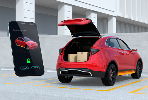 613881746 istock photo Red SUV in parking lot with opened trunk, cardboard boxes inside. Smartphone app on the left for unlock the car trunk 956056962