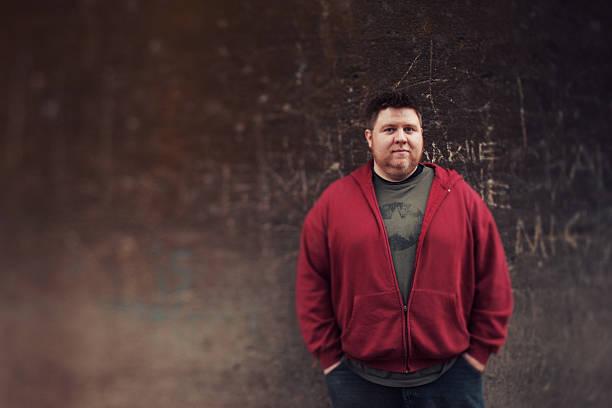Red Sweatshirt Tilt Shifted Grunge Wall Man stock photo