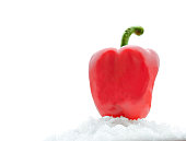 Red sweet pepper isolated on white snow