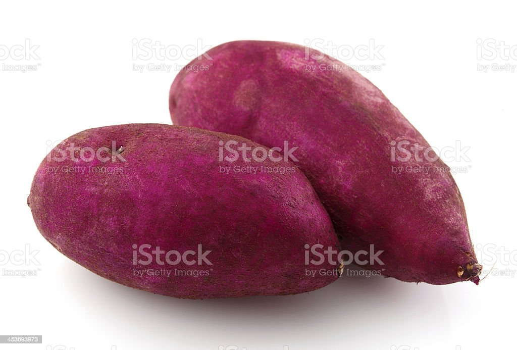 Red sweet potatoes on a white background stock photo
