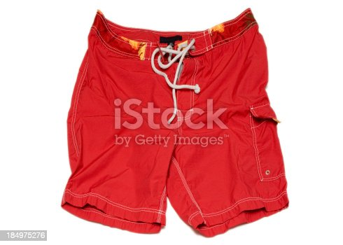 Bright red swimming shorts (swimming trunks) isolated on white background. Clipping path included